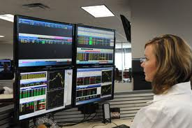 forex trader in front of screens